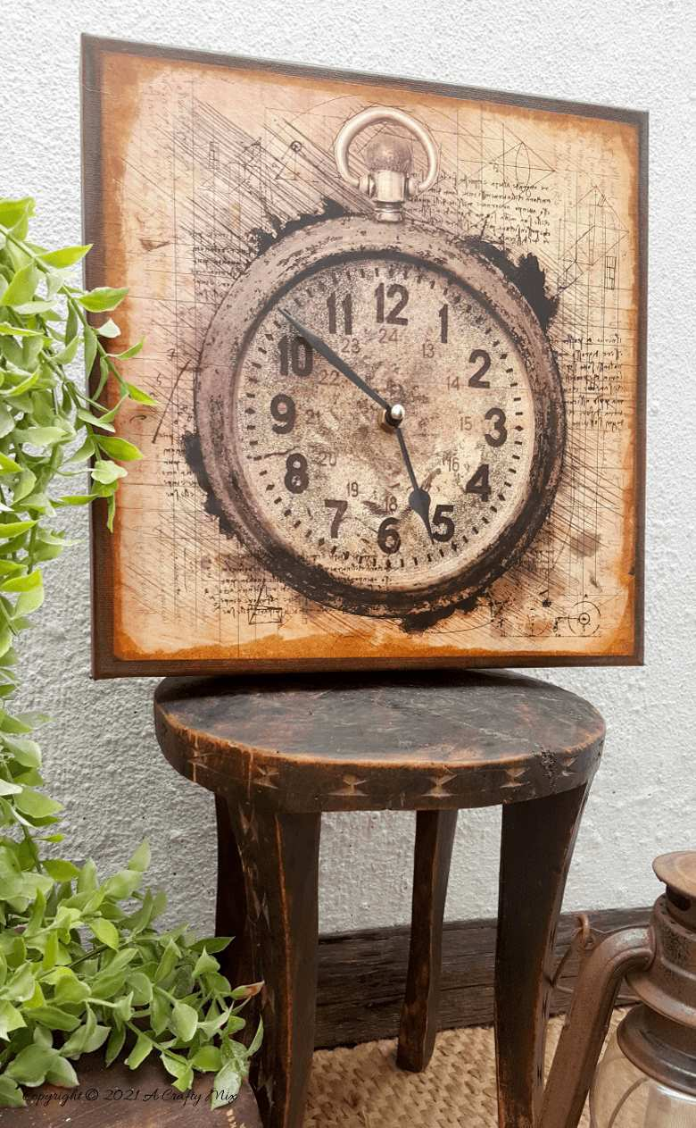 Make a unique statement with this DIY Da Vinci canvas clock. It's quick and easy and the tutorial includes step-by-step instructions along with a free printable. #DIYClock #ACraftyMix #HomeDecor
