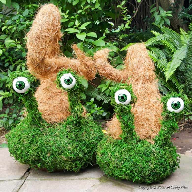 Add a little light-hearted fun to your porch décor with these easy to make mossy creatures. With bendable caps and popping eyes they're sure to put a smile on your face. #PorchDecor #MossCreatures #ACraftyMix