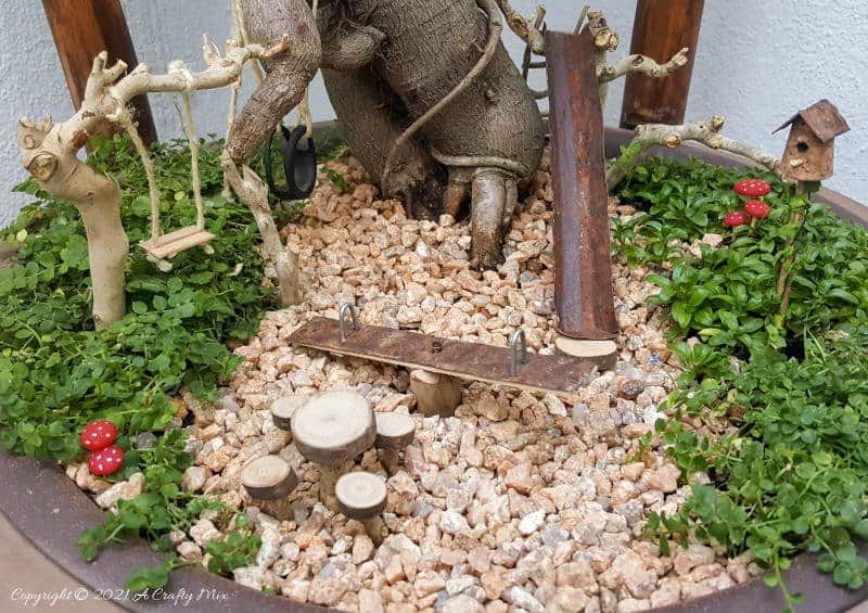 This photo-rich tutorial will show you how you can make your own fairy playground using what you have in your craft cupboard. No fancy tools needed and everything can be made in a morning #FairyGarden, #ACraftyMix, #Playground