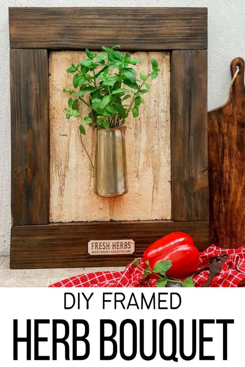 I love this fresh twist on the traditional herb garden. The framed bouquet of fresh herbs can be propped on the counter or hang it up if you prefer to keep your counters clutter free. #IndoorHerbs #IndoorGarden #FramedGarden #ACraftyMix #DistressedWall #DistressedFrame #GardenInspiration#FreshHerbs