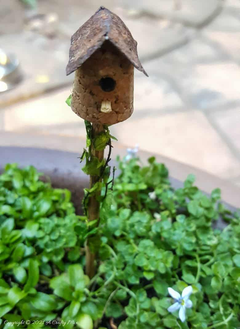 Place the fairy birdhouse in the soil