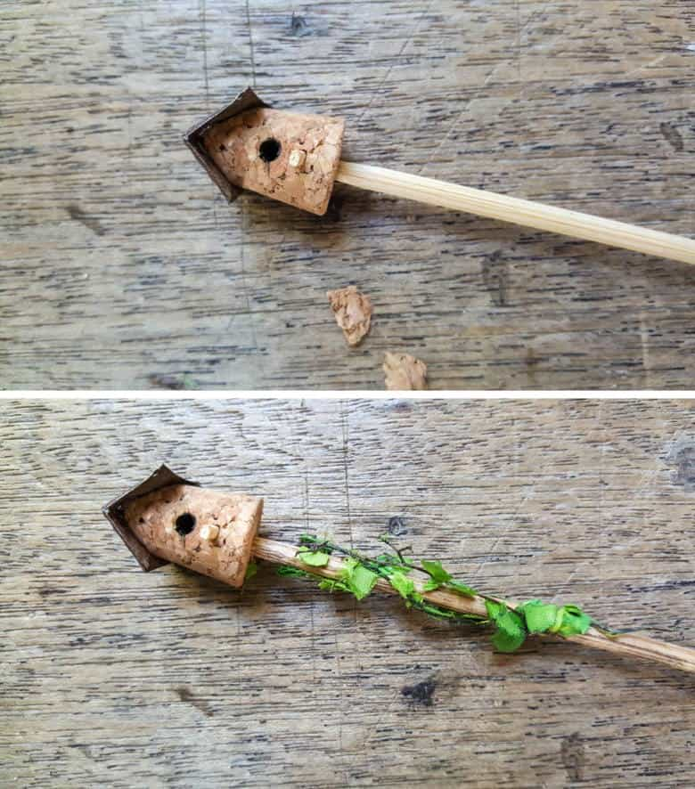 Insert a skewer inside the cork and glue some fairy vines around the base