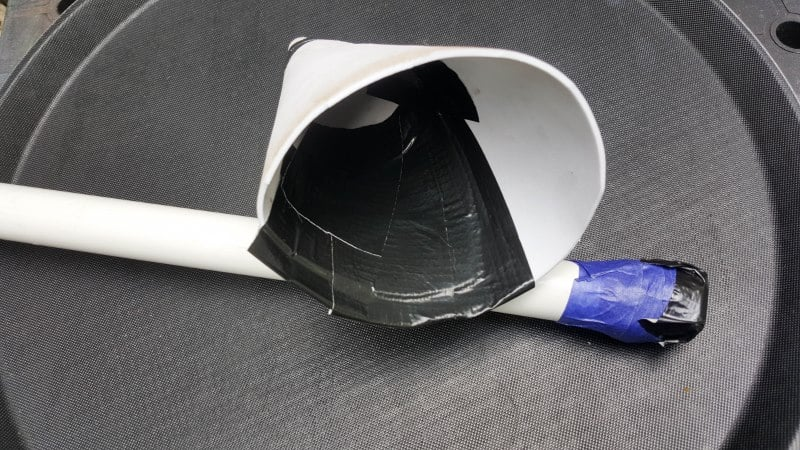 Insert baling wire into the PVC pipe and seal one end