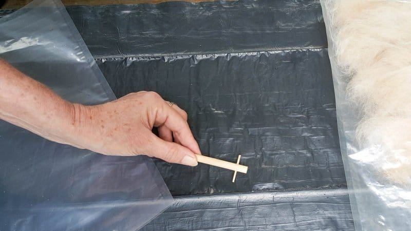 Drill a hole in a dowel and insert a toothpick to make a spindle