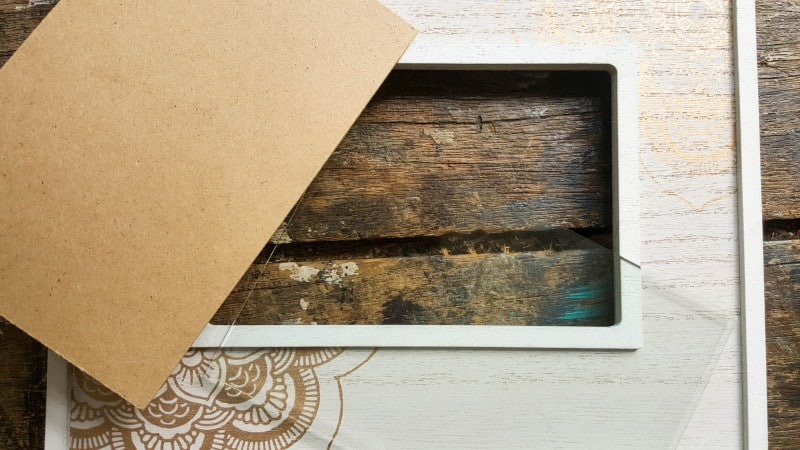 Remove the backing from the frame and put to one side