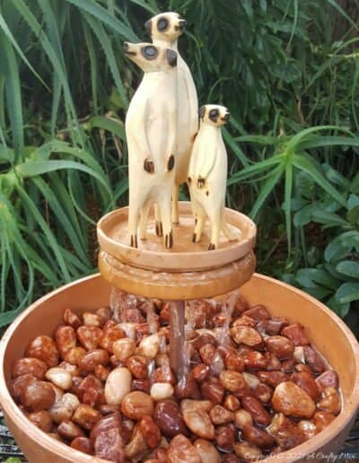 This photo-rich tutorial will show you how just how easy it is to repurpose an empty CD case and turn it in a CD spindle water feature bringing a calming, zen-like decorative feel to any space. #Spindlerepurpose #ACraftyMix #waterfeature