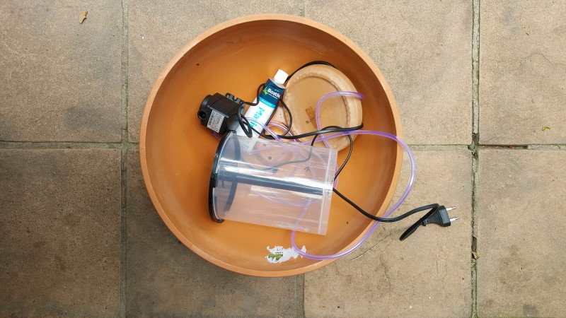 What you need to repurpose a en empty CD spindle case into a water feature